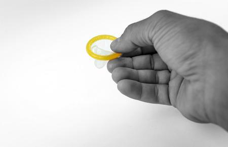 Condom close-up isolated. condom in his hand.
