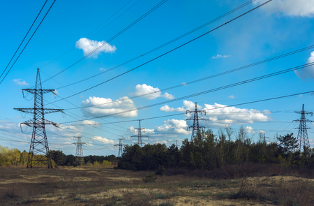 high-voltage  power lines at  clouds in the forest. electricity distribution station. high voltage electric transmission tower.