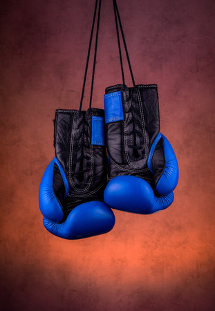 blue boxing gloves hanging on the wall, close-up. motivation in sport. Stok Fotoğraf