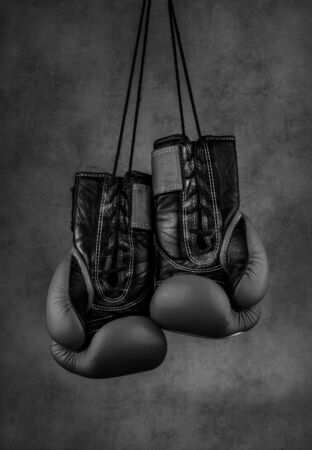 black boxing gloves hanging on the wall, close-up. motivation in sport. 写真素材