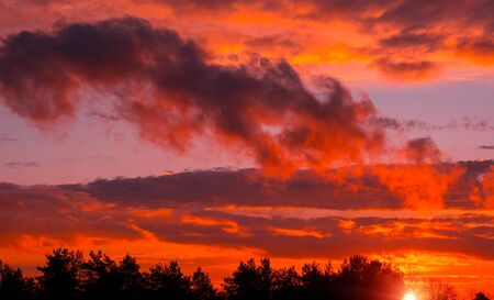 Fiery orange sunset colorful and speckled  clouds. Beautiful sky. Stok Fotoğraf