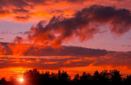 Fiery orange sunset colorful and speckled  clouds. Beautiful sky. 스톡 콘텐츠