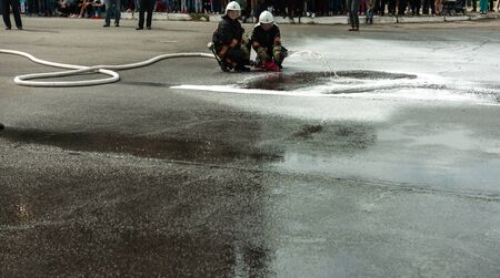 fireman extinguishes the fire with smoke. Firefighting exercises with fire extinguishing.