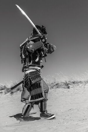 Samurai in ancient armor, with a sword ready to attack close-up 写真素材