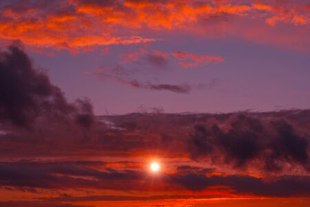 Fiery orange sunset colorful and speckled  clouds. Beautiful sky. Stock Photo