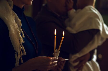 Christening in the church. Catholicism and Orthodoxy, faith. candle on a blurred background.