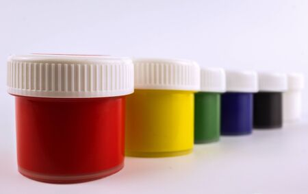 paints for drawing by a brush, colors of a rainbow. A tool for drawing.