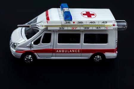 ambulance car with thermometer on blured background. Ambulance auto paramedic emergency.