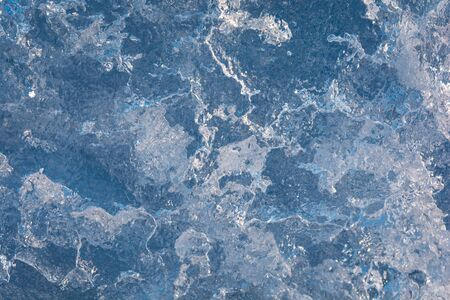 texture of the ice surface with bubbles. abstract winter background.