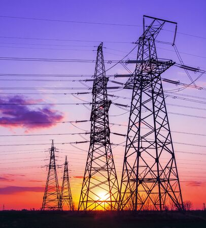 high-voltage power lines at sunset. electricity distribution station. high voltage electric transmission tower. Archivio Fotografico
