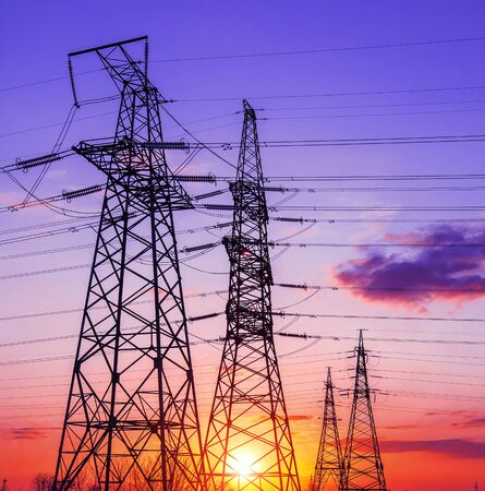 high-voltage  power lines at sunset. electricity distribution station. high voltage electric transmission tower. Foto de archivo - 150434941