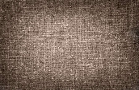 Burlap close-up, natural coarse cloth, tablecloth with folds