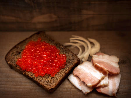red salmon caviar on a slice of bread