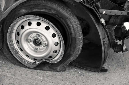 Accident on the road with damage to the car. violation of the rules of road driving. knocked wheel.