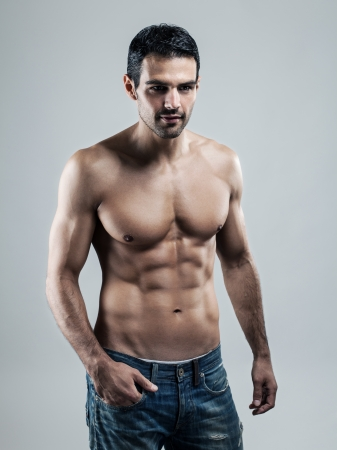 nude abs: A handsome muscular man posing at a studio  Stock Photo