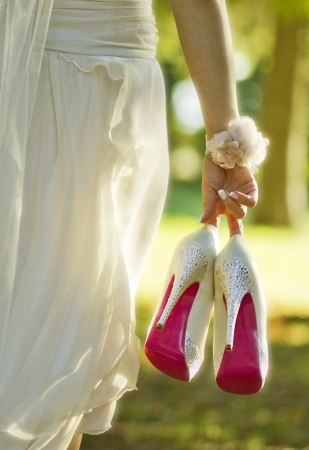 foot gear: Bride with wedding shoes  Selective focus