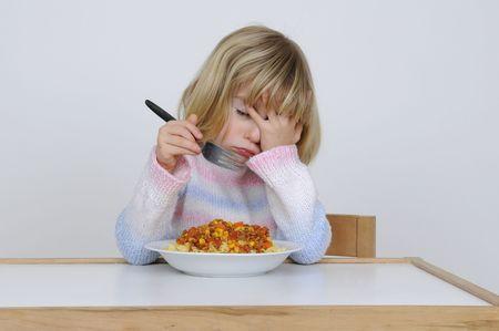 little girl will not eating photo