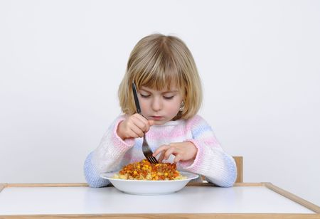 ornery: Little girl eats noodles with ketchup