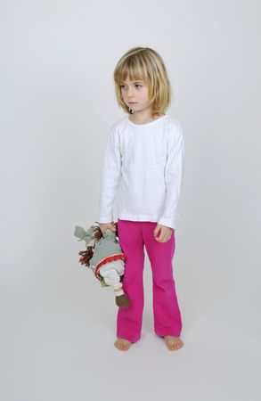 phlegmatic:  little girl in pajama with puppet Stock Photo