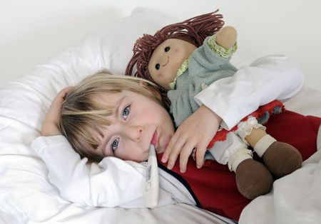 snuff: blond little girl with clinical thermometer in bed