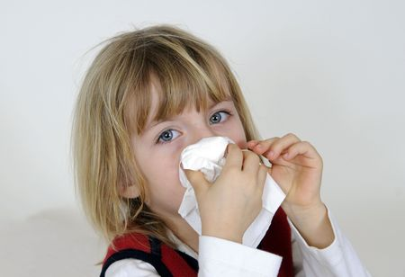 hayfever: blond little girl with handkerchief