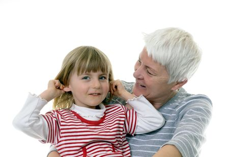 dearly: grandma and granddaughter laugh Stock Photo