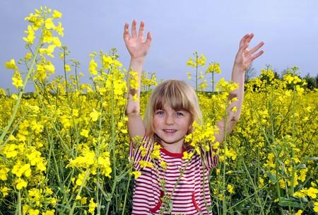 little girl in field of rape Stock Photo - 7004691