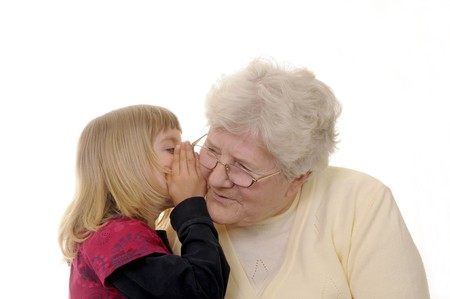 grandma and granddaughter whispering photo