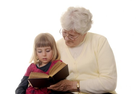 white-haired grandma read to granddaughter  photo