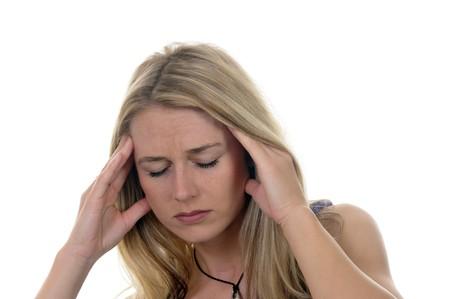 headaches: young woman has headaches