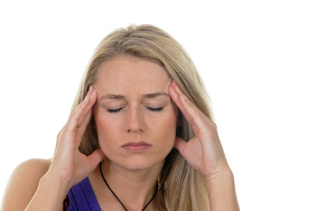 overtired: young woman has headaches