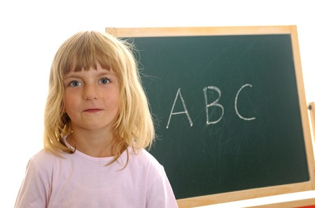 little girl in front of board with ABC Stock Photo - 7592159
