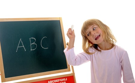 little girl in front of board with ABC photo