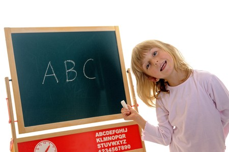 little girl in front of board with ABC Stock Photo