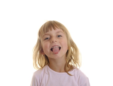 grins: little girl puts out her tongue