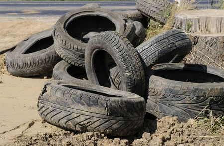 old tires on the roadside Stock Photo