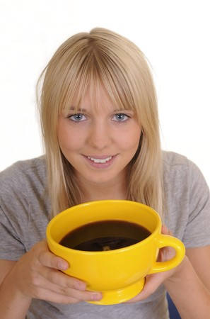 young blond woman in front of white background with a cup of coffee photo