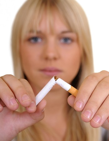 young woman breaks a cigarette Stock Photo