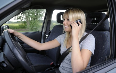 forbade: woman with mobile phone in the car Stock Photo