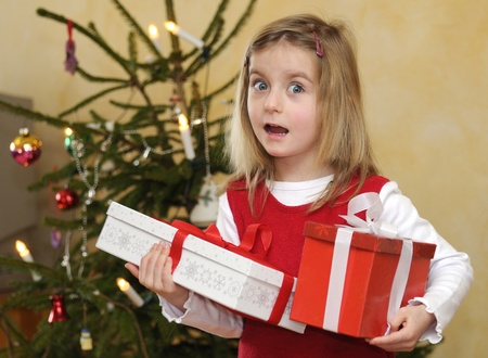 little girl with christmas gift Stock Photo - 8559632