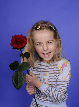 little girl with red rose photo