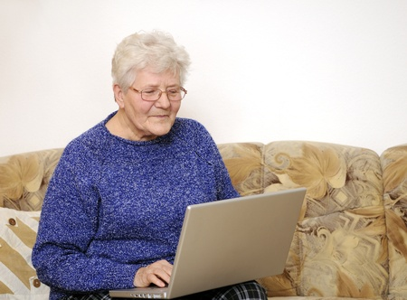 older woman working on laptop Stock Photo - 8820031