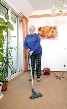 grizzled: elderly woman with vacuum cleaner