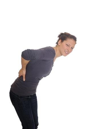 굽힘: 젊은 여자가 허리 통증이 있습니다 스톡 사진