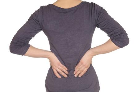 mujeres de espalda:  lumbalgia - manos en la espalda  Foto de archivo