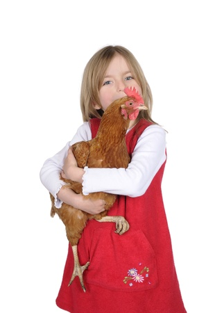 little girl with chicken photo
