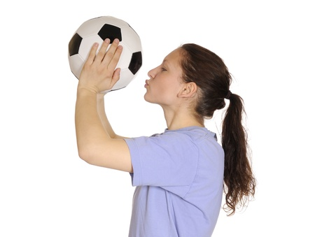 young woman kissing a soccer ball Stock Photo - 9256269