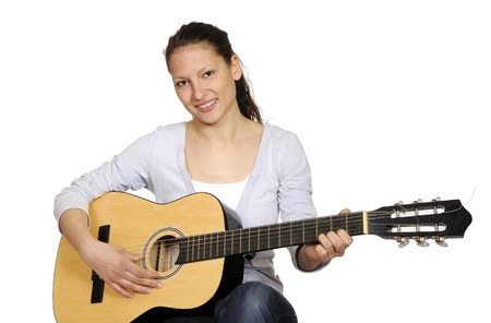 young girl plays guitar