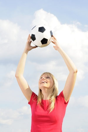 young woman with soccer ball photo