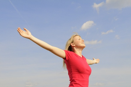 happy young woman spreads her arms Фото со стока